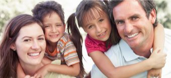 family happy together after working with a Grand Rapids skilled family law attorney