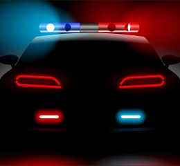 police car with lights on dark background representing an arrest of a person who is contacting grand rapids criminal defense lawyers best