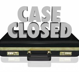 Case Closed words in 3d letters on a black leather briefcase to illustrate a lawsuit won by criminal defense attorneys best grand rapids