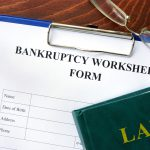Bankruptcy worksheet and law folder on the desk of a Grand Rapids bankruptcy attorney