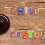 Judge gavel and colourful letters regarding child custody, family law concept for a family law attorney grand rapids