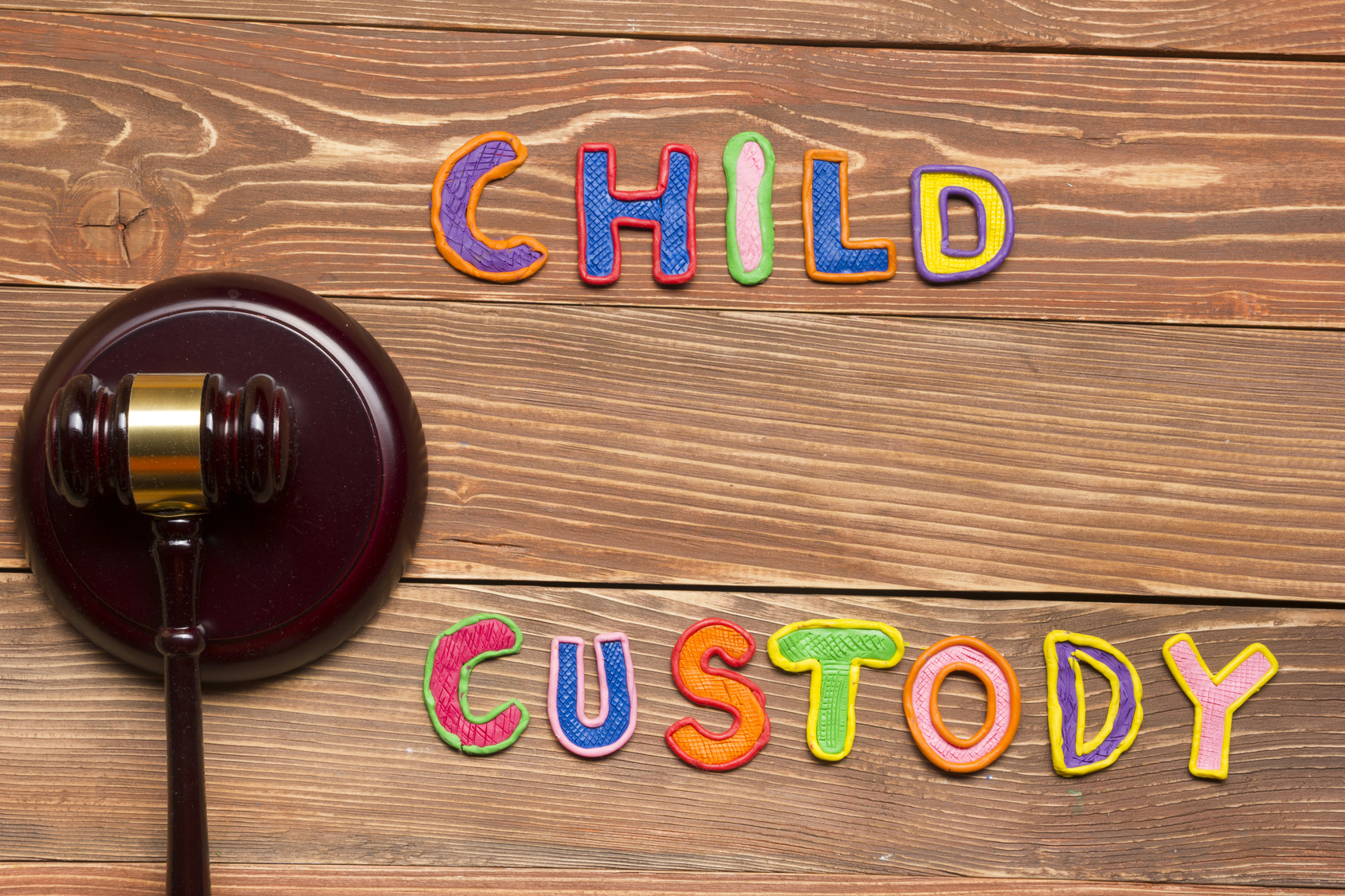Judge gavel and colourful letters regarding child