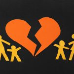 Paper family with broken heart from Rockford child custody lawyers