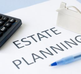 Estate planning paper with calculator from estate planning lawyer in Caledonia