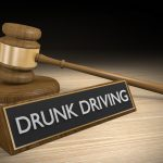 Drunk driving name tag on desk with gavel from Middleville DUI law firm