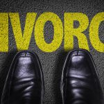 business shoes and divorce written in yellow on the ground for a top divorce lawyer in michigan