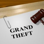 "3D illustration of ""GRAND THEFT"" title on legal document for a grand rapids theft attorney"