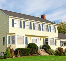 Yellow New England Style colonial house reoresents the work of wills attorneys in Grand Rapids