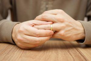 man considering divorce seeking legal counsel with family law attorney in grand rapids