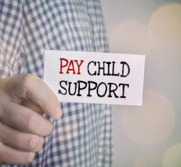 man showing pay child support reminder for when determining child support payments with a knowledgeable family law attorney in Caledonia