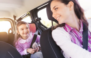 girl in car with her mother driving her to school, when needing your rightful parenting time contact a good child custody lawyer in Ludington