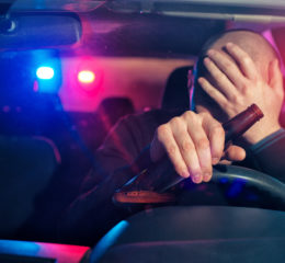 Man driving and drinking, he needs to contact a good DUI arrest defense attorney in Grand Rapids.