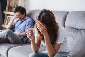 A married couple that are upset over the end of their marriage. Speak to a knowledgeable Ludington Divorce Attorney.
