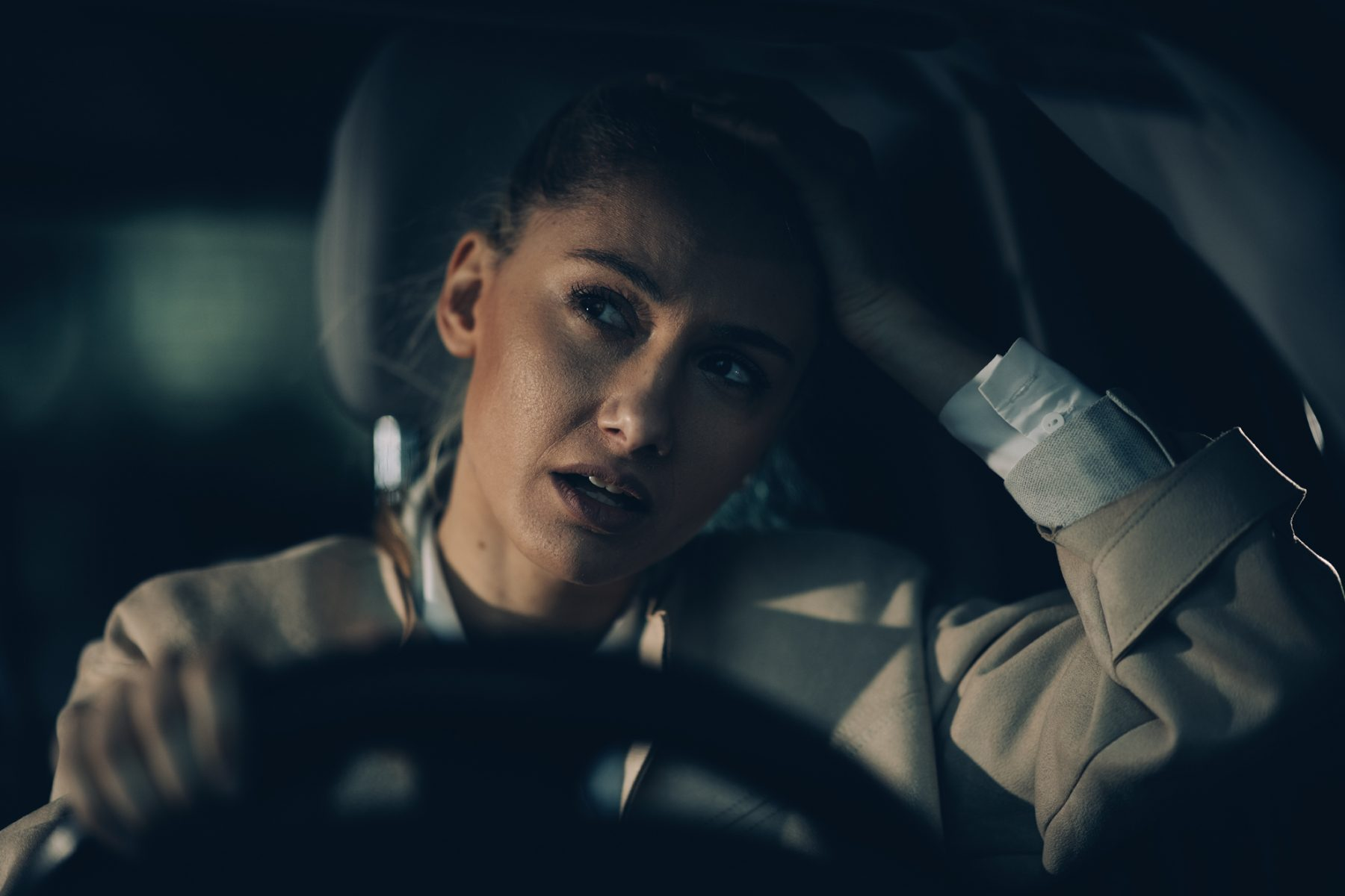 Woman annoyed driving, if you have had your drivers license suspended it is important to see a Ypsilanti License Restoration Lawyer for help.