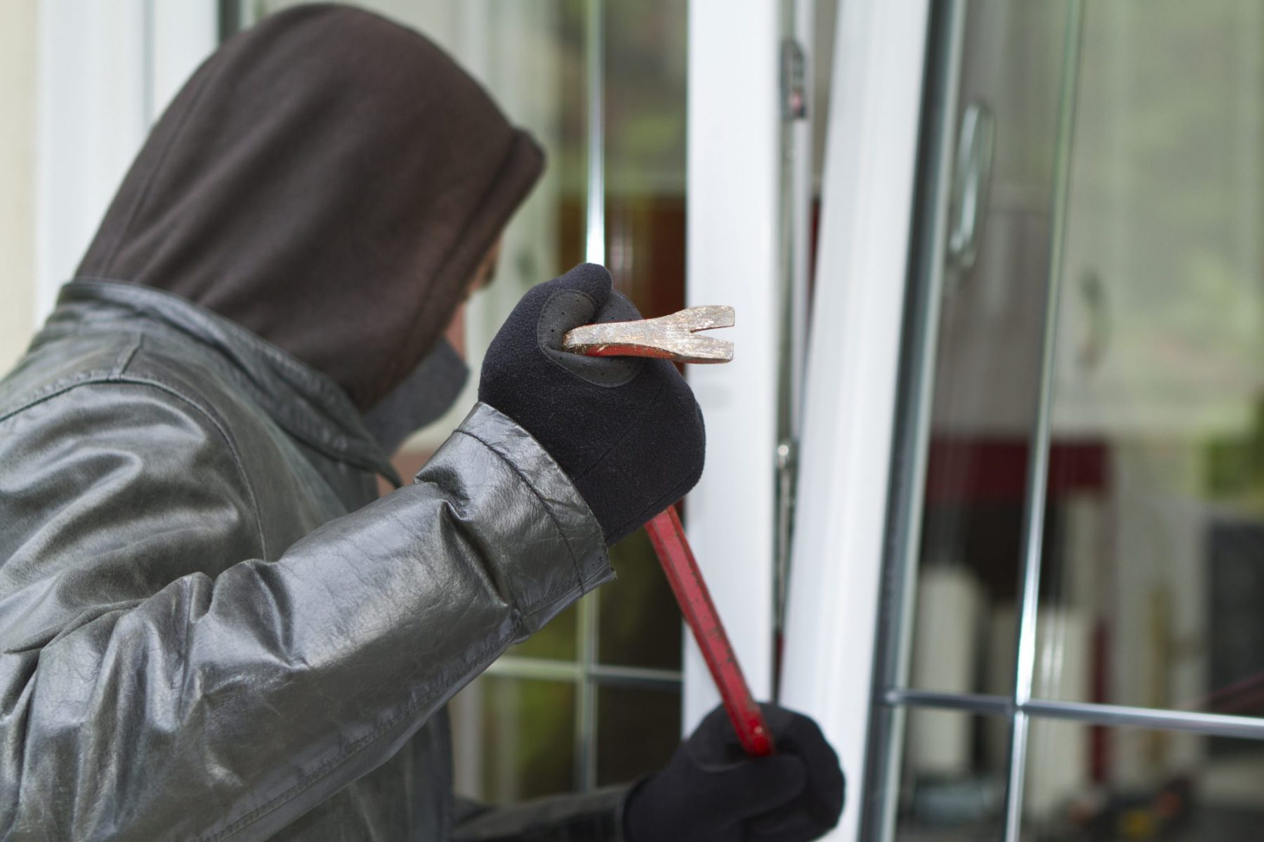 Man trying to break into a home with crowbar, if arrested on a breaking and entering charge meet with our Grand Rapids Criminal Defense Law Office.