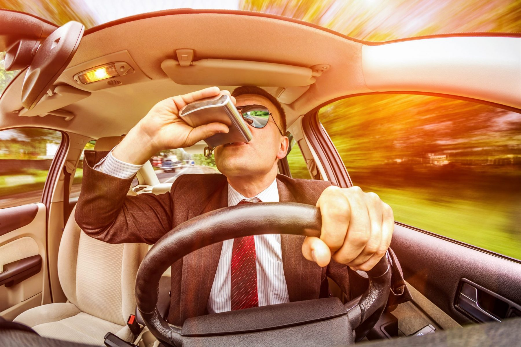 A man drinking from a flask while driving and getting an OVI, he needs a good Grand Rapids DUI Lawyer.