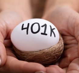 A woman holding a nest with egg marked 401k, for help dividing your marital property meet with Grand Rapids Family Lawyer.