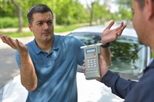 A possible drunk driver questioning a breathalyzer test, trust in Grand Rapids DUI defense lawyer for help with your case.