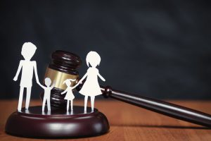 Paper cutouts of a family of four with gavel, for Family Law Attorney Near Me contact our office to discuss your child custody case.