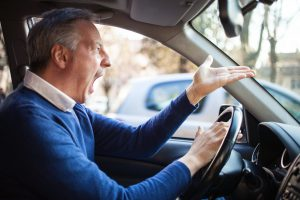 Angry male driver, with the pandemic meet with a qualified Michigan defense attorney if arrested for a DUI.